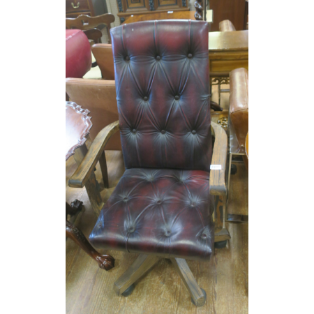 A PITCH PINE AND HIDE UPHOLSTERED SWIVEL CHAIR