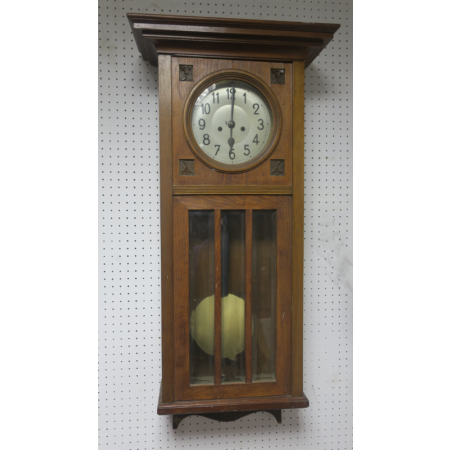 A PINE CASED WALL CLOCK