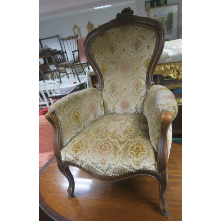 A CONTINENTAL STAINED BEECHWOOD AND UPHOLSTERED GENTLEMAN'S CHAIR