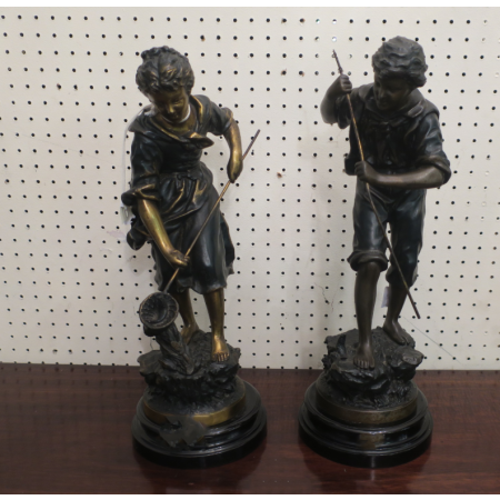 A PAIR OF BRONZED FIGURES boy and girl