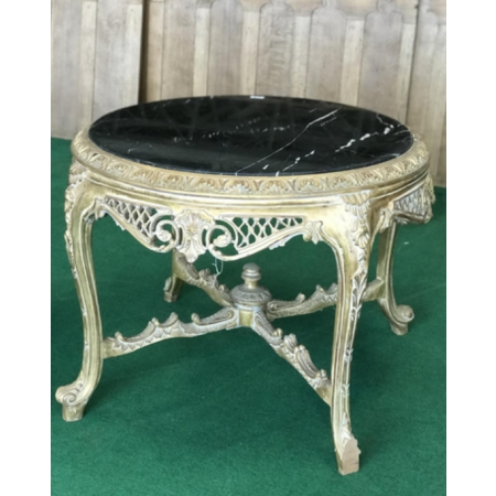 Center table with black inset marble top held aloft by carved wood and gilt base 42'' x 34'' H