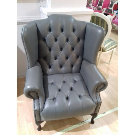 Grey leather upholstered wing back