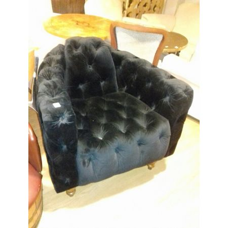 Deep buttoned aviation armchair