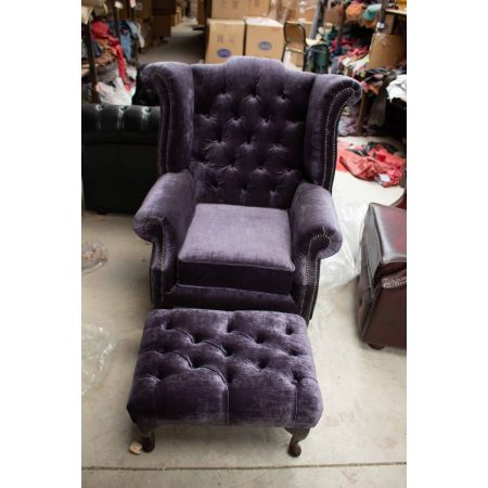 Dark purple velvet upholstered wing back chair with stool