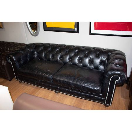 Black leather deep buttoned chesterfield sofa
