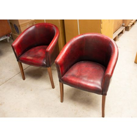 Pair of red leather tub chairs