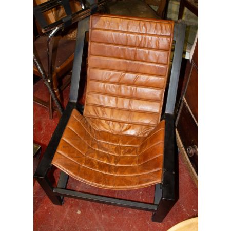 Tan leather and black frame chair