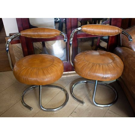 Pair of chrome frame and tan leather stools