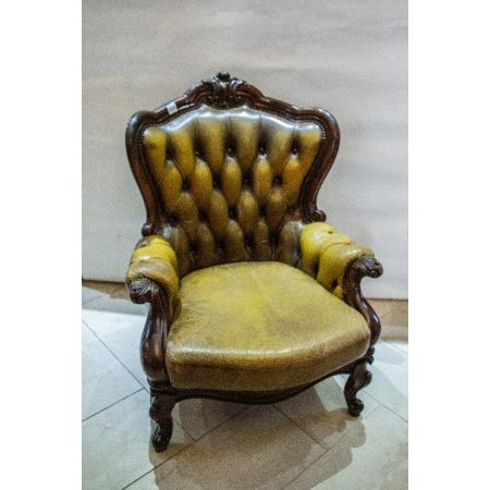Green leather carved armchair