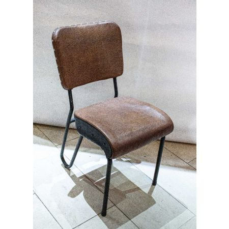 Tan leather seat on springs chair