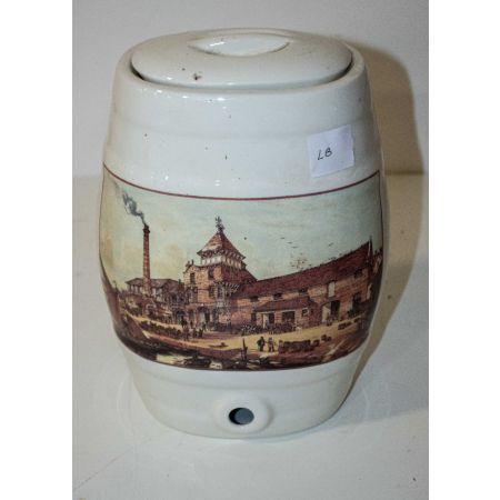 Ceramic dispenser with factory scene
