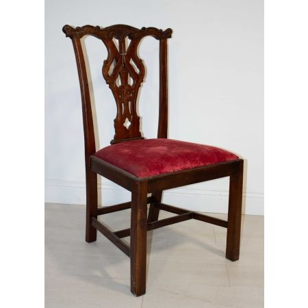 Carved back red velvet chair