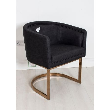 Black upholstered tub chair on chrome legs